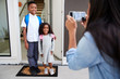canvas print picture - Mother Taking Photo Of Children With Cell Phone On First Day Back At School