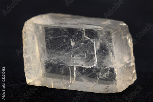 Fotografia, Obraz  Raw Iceland spar from Krasnoyarsk region, Russia on black cement background