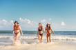 Women friends walking and enjoying at the beach