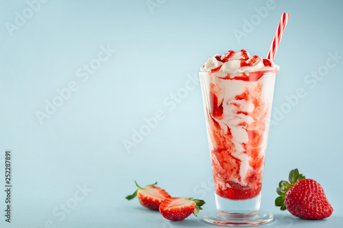 Strawberry milkshake with whipped cream.