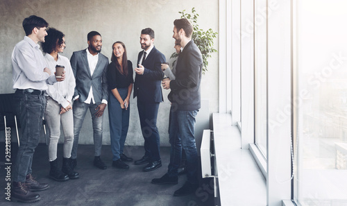 canvas print motiv - Prostock-studio : Business colleagues having coffee break near window