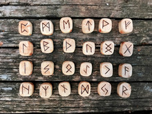 A Stack Of Wooden Runes At For...