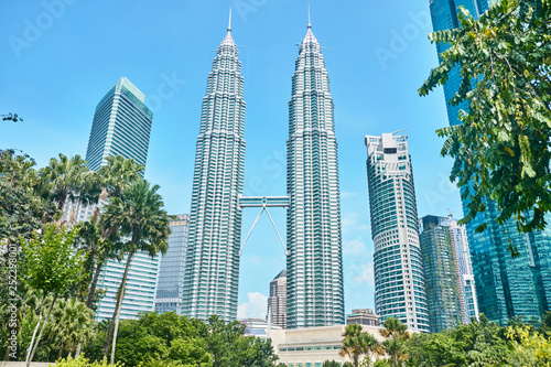 Photo Stands Kuala Lumpur Petronas Towers in Kuala Lumpur.