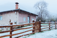 Old Building And Wooden Fence In Winter