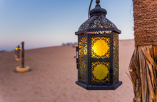 Poles With Lanterns In Desert