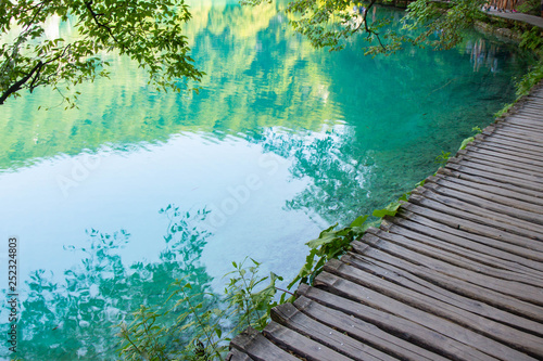 Canvas Prints Green coral wooden footpath through Plitvice lakes national park