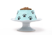 Dog Food Birthday Cake On A Cake Stand Isolated On White Background