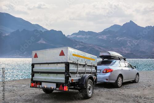 Fotografie, Obraz Car trailer by the sea