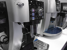 Automatic Coffee Machines At Exhibition On White Kitchen Background
