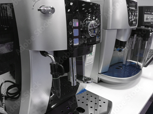 Vászonkép automatic coffee machines at exhibition on white kitchen background