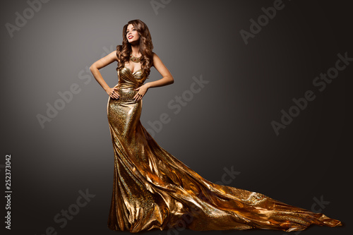 Fotografie, Obraz  Woman Gold Dress, Fashion Model Gown with Long Tail Train, Young Girl Beauty Por