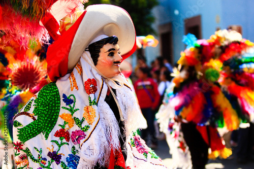 Fototapeta  a huehue mexican carnival dancer dancing with a colorful folk costume