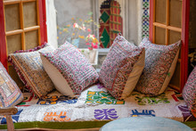 A Cozy Seating Area Near The Window With Colorful Pillows With A Wonderful View Of The Courtyard In Udaipur, Rajasthan, India.