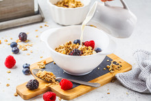 Breakfast Food Background. Granola With Milk And Berries On White Table.