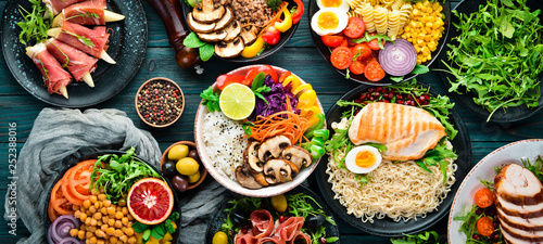 Assortment of healthy food dishes. Top view. Free space for your text. - 252388016