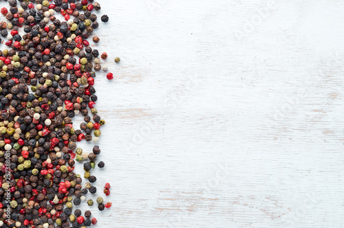 Fototapety, obrazy: Red and black pepper on a wooden background. Spices Top view. Free space for your text.