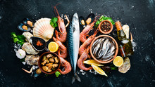 Fresh Seafood On A Stone Background. Fish, Shrimp, Mussels, Caviar. Top View. Free Copy Space.