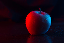 One Apple On The Table. Neon L...