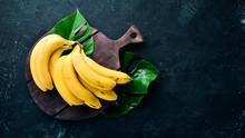 Fresh Yellow Bananas On A Blac...