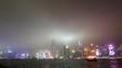Night Hong Kong cityscape across harbor waters bright illumination