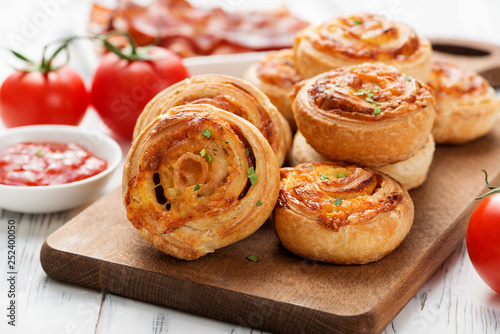 Wallpaper Mural Rolls of puff pastry with bacon and cheese .