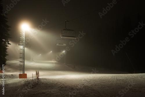 Fotografía  Illuminated ski piste at night - night skiing, Mountain Kopaonik, Serbia