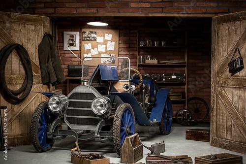Fotografie, Obraz Retro car in the garage for repairs