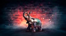 Golden Elephant On A Wooden Ta...