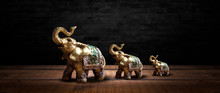 Golden Elephant On A Wooden Ta...