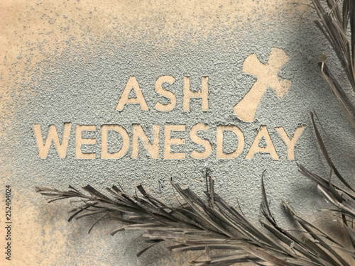 Photo Ash Wednesday concept - Ash Wednesday words and a cross formed out of ashes
