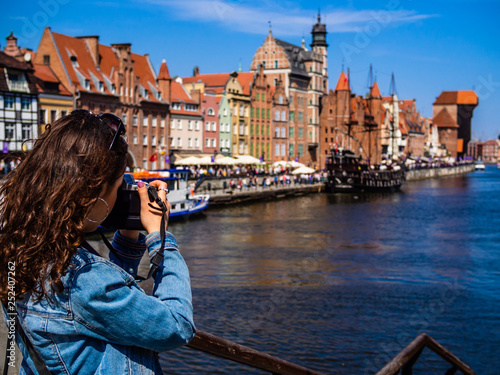 Fotografia Young woman taking pictures