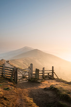 Stunning Winter Sunrise Landscape Image Of The Great Ridge In The Peak District In England With A Cloud Inversion And Mist In The Hope Valley With A Lovely Orange Glow