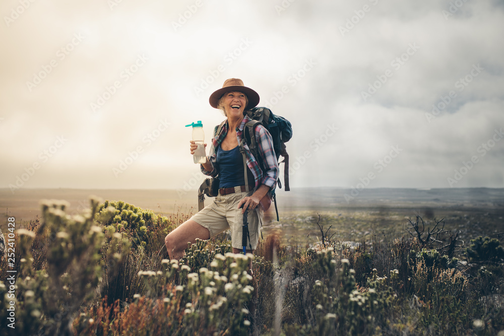 Fototapety, obrazy: Female hiker relaxing during a trek