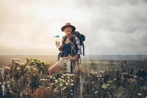 Fototapeta Female hiker relaxing during a trek obraz
