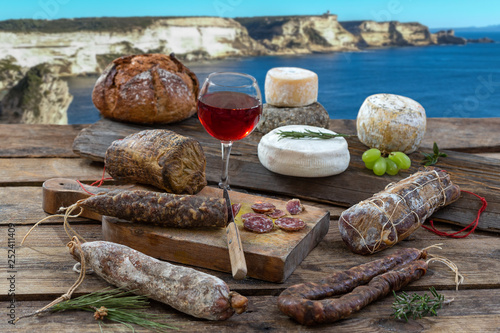 Fototapeta Corsican specialities: delicatessen, and cheese made in Corsica with the Porto v