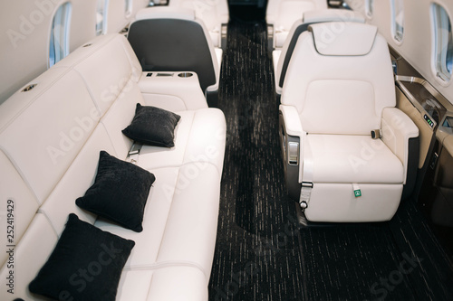 Business jet plane interior with leather seats and sofa Tableau sur Toile