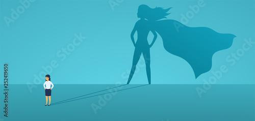 Fotografie, Obraz Business woman with big shadow superhero
