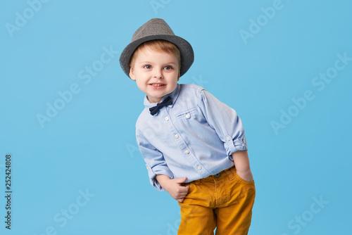 Photo  Portrait of happy joyful  little boy isolated on blue background
