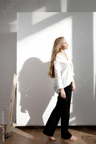 Fotografie, Obraz  Beautiful fresh blonde model in white shirt and black trousers