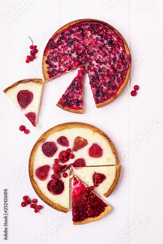Fotografia, Obraz  Two Beries Pie Tasty Homemade Berries Pie Tart with Strawberries and Whipped Cre