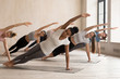 canvas print picture - Group of women practicing yoga lesson, Side Plank pose