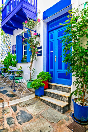 Traditional narrow streets with cute cafe bars in Greece. Skopelos island, Sporades
