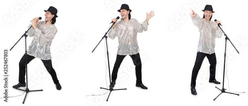 Fotografie, Obraz Young man singing with microphone isolated on white