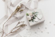 Wooden Box For Wedding Rings On A White Background With Flowers And Pearls