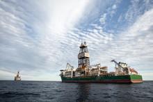 Oil Rigs Operate In The Atlantic Ocean.