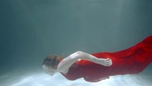A Girl In A Red Dress Dives In...