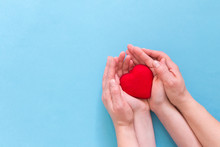 Hands Pass The Heart Of The Child To The Day Of The Donor Against The Sky, Hope For Health, For Organ Donation,blood Donor Day