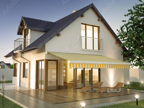 Fotografia House with terrace in the evening