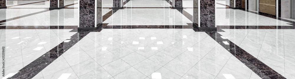 Fototapeta Marble floor of luxury lobby of company or hotel. Panorama of cleaned washed floor in corporate hallway. Shiny floor with reflections after professional cleaning. Care service of office interior.