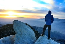 Sunset In Top Of Mount San Jacinto In Southern California With Hiker Enjoying The Awesome View